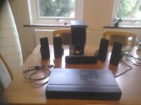 RCA DVD home theatre surround system. 5 speakers plus bass woofer; all connection leads plus remote