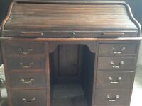 Beautiful old roll top desk.