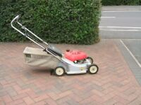lawnmower....in good working order with detachable grassbox and petrol powered
