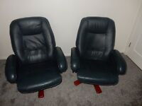 Two matching blue leather swivel/reclining chairs