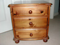Matching pair of dark pine bedside chests each with 3 drawers
