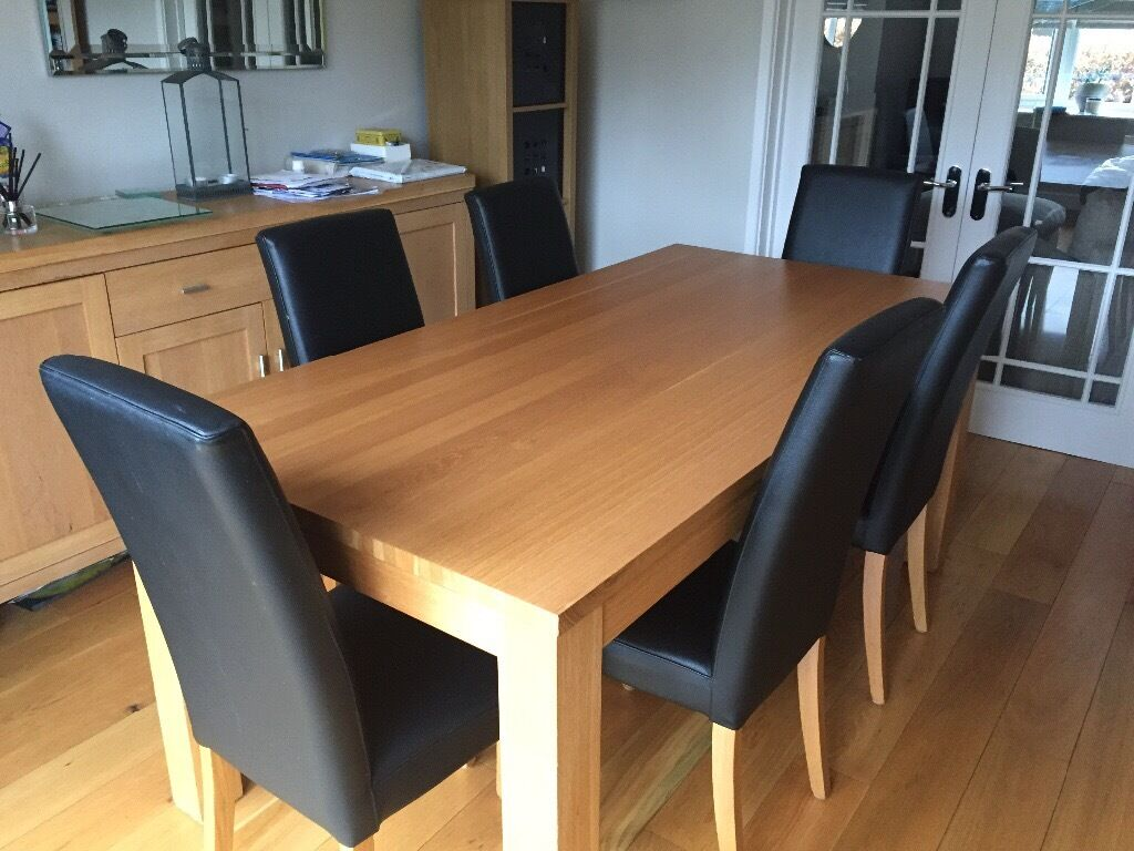 Solid Oak Dining Table With 6 Black Leather Chairs Matching Dresser