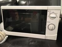 White microwave. Works perfectly.