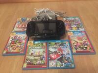 Wii U Black 32gb with 6 games.