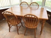 Solid pine dining / kitchen table and 4 chairs