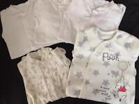 Baby girls first size babygrows & vests