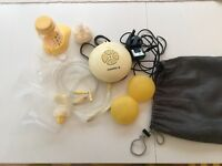 Good condition Medela swing breast pump with extras