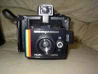 Polaroid Super colour Swinger Land Camera with carry case, instructions and spare bulb