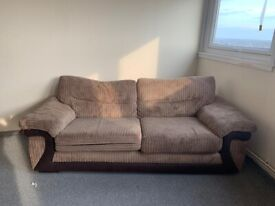 Brown swaued sofa with arm chair