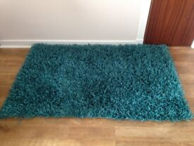 Teal rug cushion covers and curtains