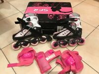 Pink/White Rollerblades/In-line skates