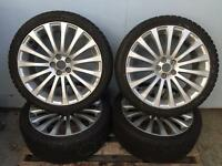 Subaru 18inch alloy wheels with brand new snow tyres