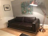 2 modern leather sofas in excellent condition