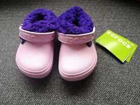 Pink BRAND NEW kids crocs with purple fluffy lining size C9