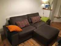 IKEA Kivik three-seat sofa and footstool with storage for sale