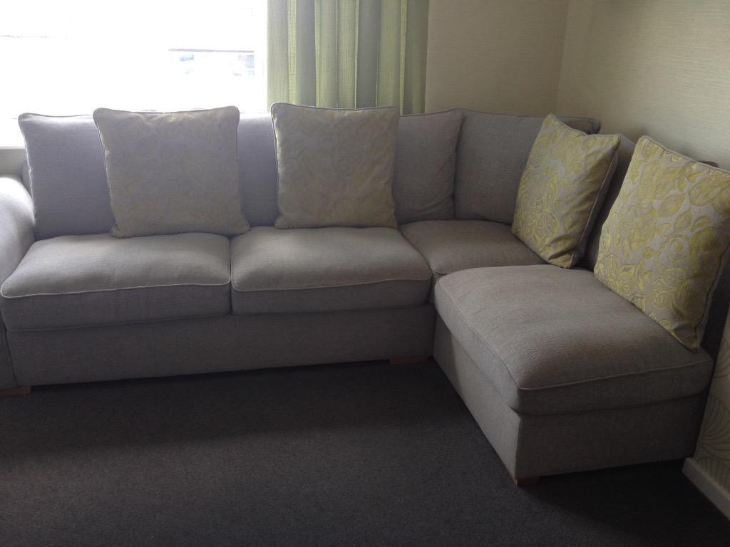 Light Grey Fabric Corner Couch With Lime Pattern Cuddle