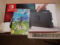 Nintendo Switch (grey) and Zelda Breath Of The Wild. Brand new never used/sealed.