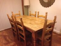 Solid pine dining table with six chairs
