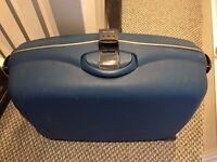 Very large, solid, blue Samsonite suitcase