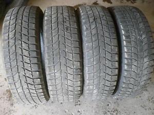 Four 225-65-17   snow tires    $100.00