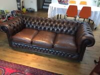 Brown three seater leather Chesterfield sofa good condition