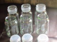 six airtight glass jars