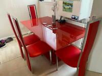Red dining table and 4 chairs