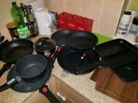 a set of pans and pots.