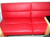 Sofa bed in red faux leather