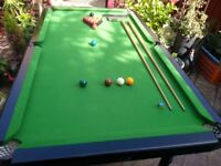 snooker table/pool, comes with balls,cue's score board,chalk triangle etc, very sturdy,bargain £50