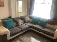 Corner grey and white sofa