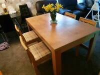 Beautiful larg heavy duty Dinning table with 4 easy to wipe waterproof chairs, strong.good condition