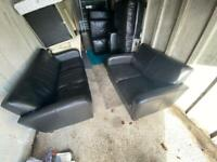 two seater and three seater black leather sofas Delivery available