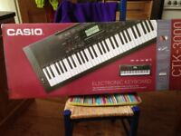 Casio Electronic Keyboard plus stand. Perfect for National 5 and Higher Music studies.