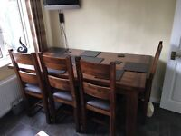 Solid oak extending dining table with 6 cushioned chairs