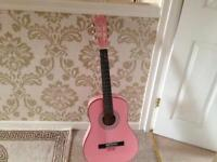 Pink Guitar in very good condition.