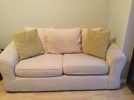 2 x 3 seater cream sofas