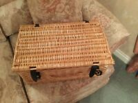 Wicker hamper basket with leather straps