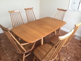 Ercol Windsor Table and 6 chairs including 2 carvers