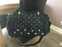 Large black studded handbag