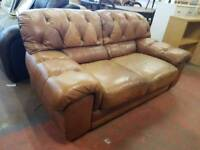 Large brown leather buttoned two seater sofa