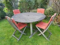Large wooden round GARDEN TABLE and 4 CHAIRS with cushions: