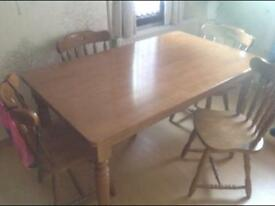 Malaysian oak dining room table and 4 chairs.