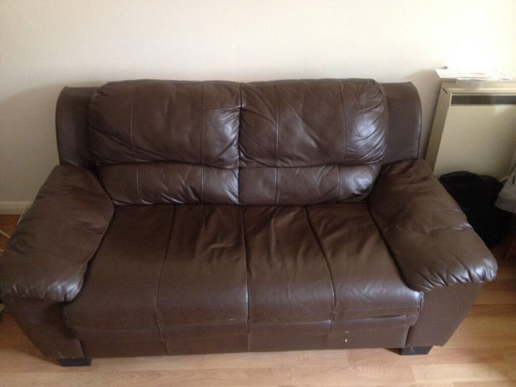 brown faux leather sofa 39 s in good condition with some