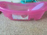 Pink sparkle and splash baby bath