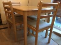 Wooden dining table and chair set, seats four