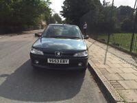 Peugeot 306 for sell, MOT, drives well, cheap.