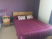 Oak effect double bed and matress, 2 x bedside tables + chest of drawers