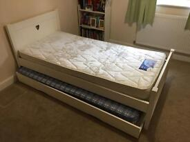 Single bed with love heart and trundle bed