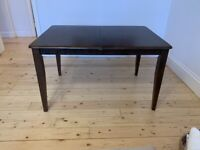 6 seat dark wood extending dining table (without chairs)